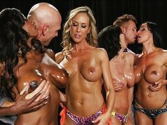 Four big-tit fitness fanatics start an orgy