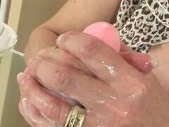 British milf gives wet dildo handjob