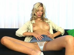 Blonde Marcy is rubbing her trimmed pussy