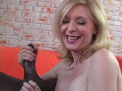 Sexy MILF Nina Hartley sucks throbbing black cock!