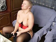 Obese pale blondie Liza uses a huge dildo for pussy polishing