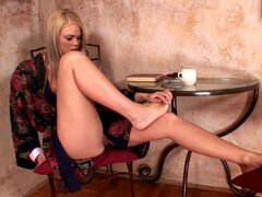 Blonde with nice feet Trisha is sucking her high heels