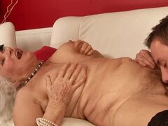 Lewd granny Norma sucks a dick and gets fucked in missionary position