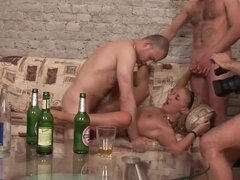 Insatiable Drunk Blonde Having a Blast with Three Cocks on the Couch