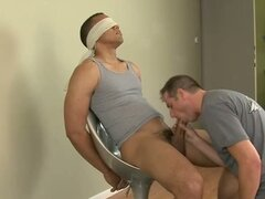 Muscular gay stud get dick sucked hard and deep while blindfolded