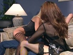 Horny babes sharing huge cock on couch