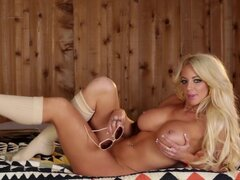 Goddess Nicolette Shea poses naked in sauna
