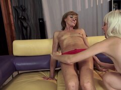 Kinky granny is fisting blondie's trimmed pussy
