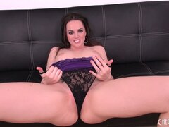 Tori Black poses on the couch and bares her perky little boobies