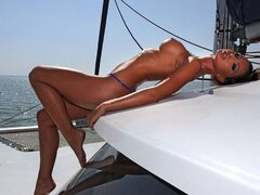 An almost unreal looking hottie gets her kit off on her rich fella's boat