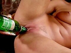 Watch this nasty blonde babe fucking beer bottle