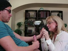 Horny momma Nina Hartley gets her pussy licked by son's friend