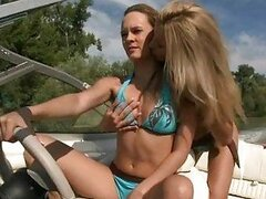 Two blonde hotties in bikini making out on a boat