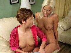 A shy, blonde teen is shown how to lesbian fuck by a more experienced hottie
