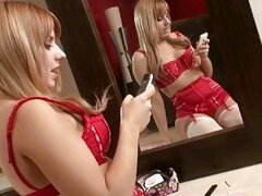 Pale blonde pornstar in red lingerie and fishnet stockings poses