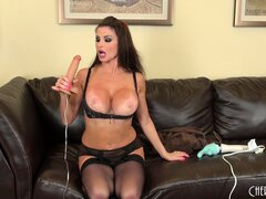 Taylor Wayne sucks on a dildo while posing in all black lingerie