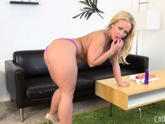Busty blonde hottie, Austin Taylor likes to warm the dildo with her big boobs