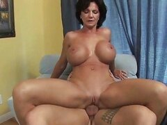 Busty MILF shags with her young horny patient
