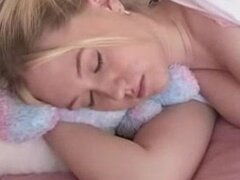 Sweet and innocent blonde is caught sleeping and is given a great waking-up!