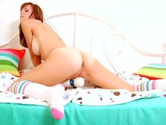 Slim redhead babe Hayden Winters is playing with vibrator