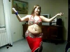 A chubby white MILF shows off her belly dancing moves in a sexy solo show