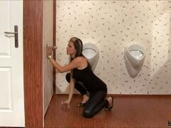 Smoking is bad for you but gloryholes can be great! This sexy slut has got a serious oral fixation by first sucking on a cigarette and then sucking on our rubber dork. She gives the toy a good blowjob before it surprises her with a powerful stream of slim