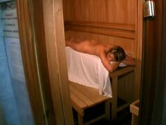 Naked blonde voyeur in sauna