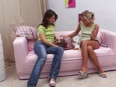 A brunette and blond girl having sex