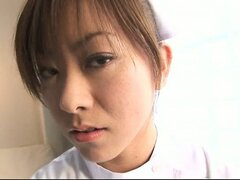 Horny Nurse Miina fingers her pussy on the exam bed