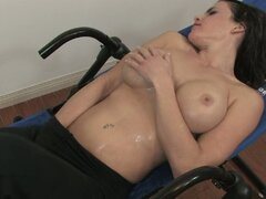 Brunette plays with her own pussy after working out