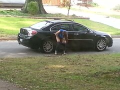Girl caught on voyeur cam pissing on the car wheel