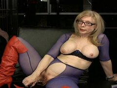 Skillful mature is posing in the nice bodystocking
