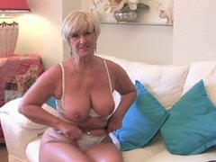 Blonde granny plays with her pussy