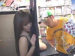 Girl in convenience store shows tits to customers