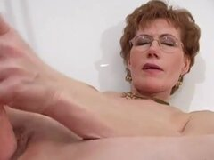 Mature masturbates freshly shaved vagina