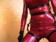 Susan Wayland in red latex catsuit