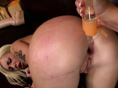 Bending forward, the sexy blonde has a curvy brunette fisting her tight ass