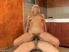 Blonde hoochie mama gets her hairy muff pumped with young cum