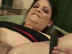 Huge milf uses a hair brush for her hairy pussy before getting banged