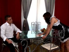 Busty and hot maid is doing blowjob on the table