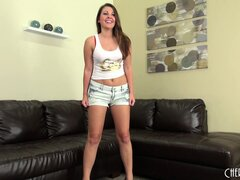 Cali Hayes reclines on her black sofa and rubs her soft snatch