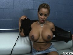 Slutty, tattooed ebony MILF likes to suck on juicy white meat