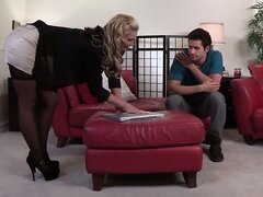 Sexy blonde busty MILF in stockings pleasing young lucky guy