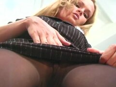 Sensual secretary is playing with her nylons