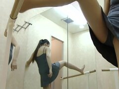 An Asian ballet dancer shows her pussy in a changing room
