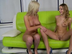 Two stunning blondes lick...