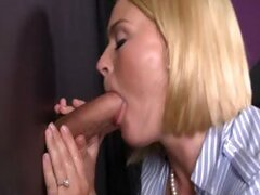 Krissy gets to have fun with two dicks behind the glory hole.