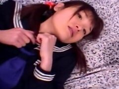 Japanese babe Manami Yuki is poking her vagina