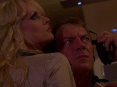 Busty sheriff Stormy Daniels punishes a dude by a stout cock riding