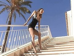 Blue Angel outdoors on a sunny day stripping and fingering her pink pussy